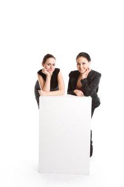 Businesswomen with billboard