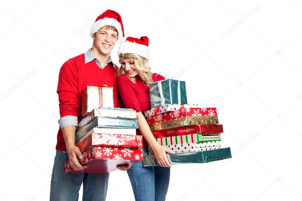 Christmas shopping couple carrying gifts