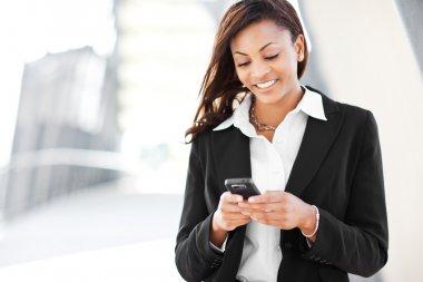 Black businesswoman texting