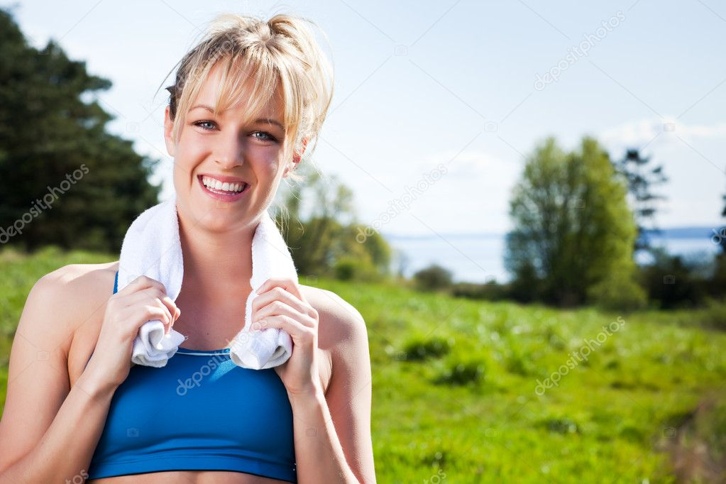 A shot of a beautiful caucasian woman exercises outdoor