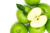 Fotografie Green apple fruits and half of apple and green leaves