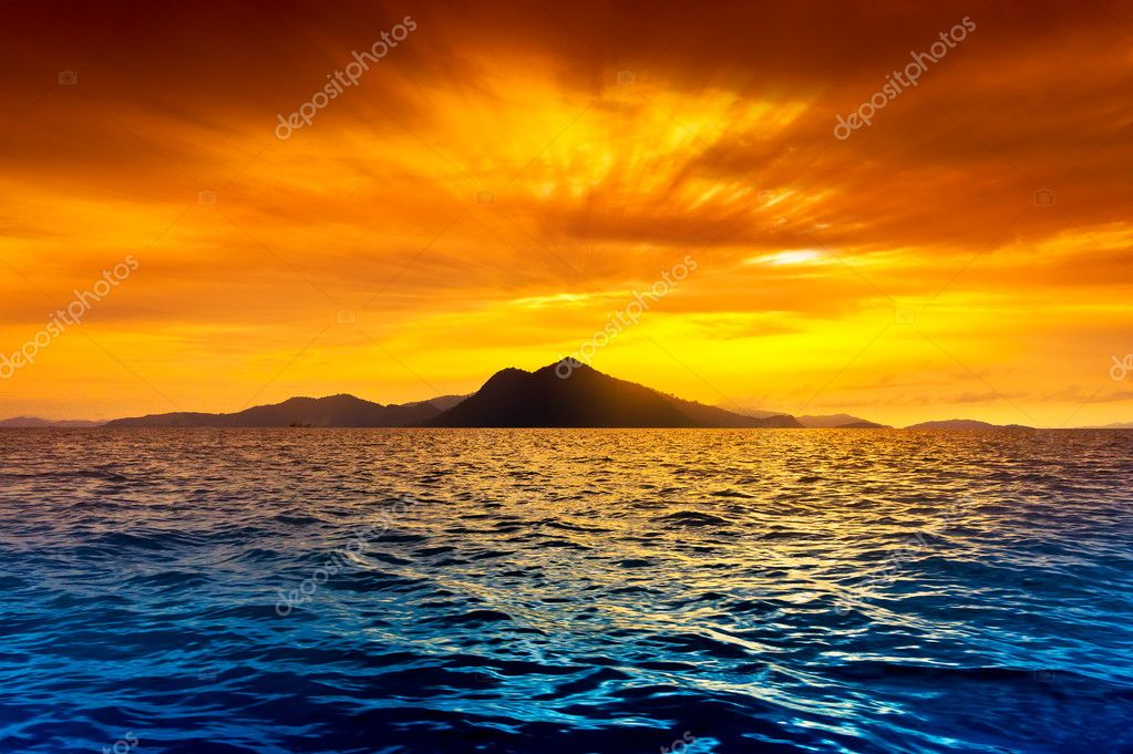 Scenic view of island during sunset