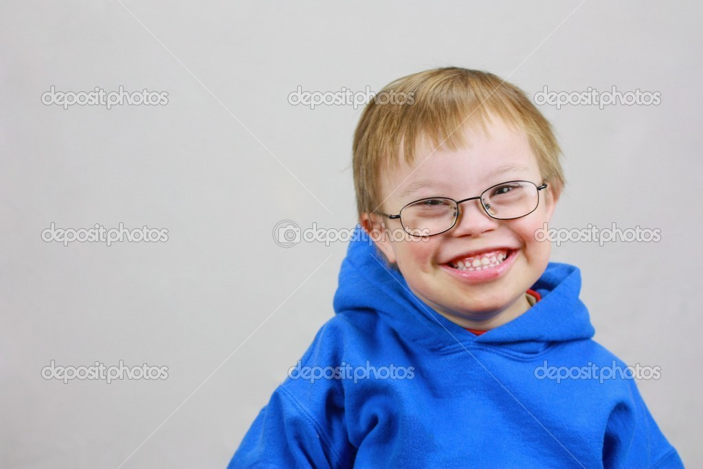 Little boy with Downs Syndrome and very happy smile