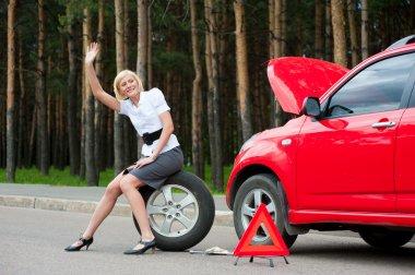 Blonde and broken car