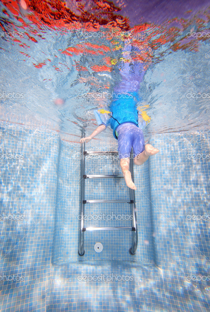 Underwater Photo Of Young Boy Climbing Out Of Swimming Pool Stock Photo Freefly 6227528