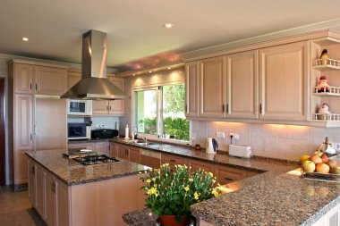 Kitchen interior of large spanish villa. With fresh flowers and