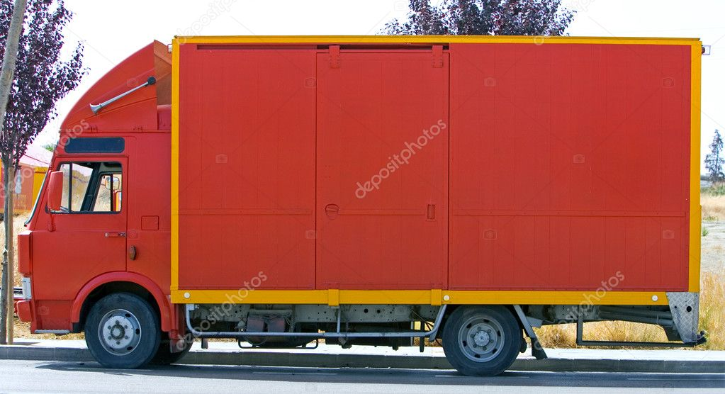 Plain red lorry or van side view