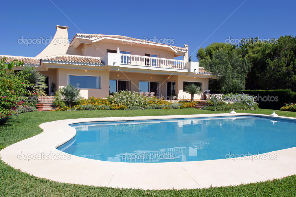 Luxury swimming pool and exterior of villa in Spain