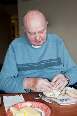Elderly Man Eating Dinner
