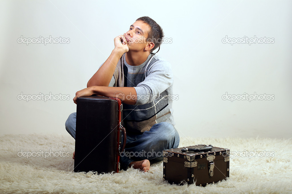 A man and a suitcase