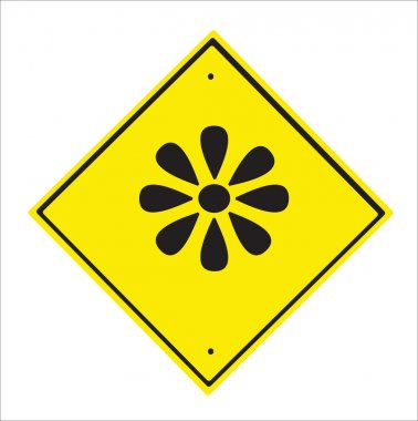 Background. A traffic sign designating the sun