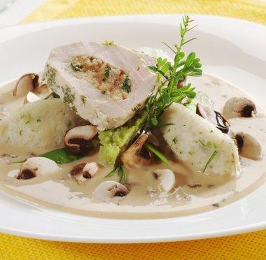 Chicken roll and potato dumplings in mushroom sauce