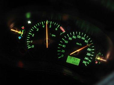 Sports car dashboard at night