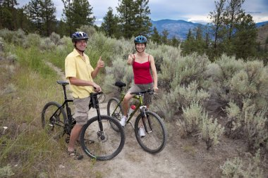 Healthy Couple with Mtn Bikes