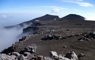 Panoramic view from mount Etna with sea and towns beneath, Sicil