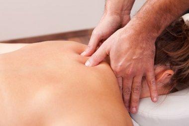 Young beautiful woman getting back massage