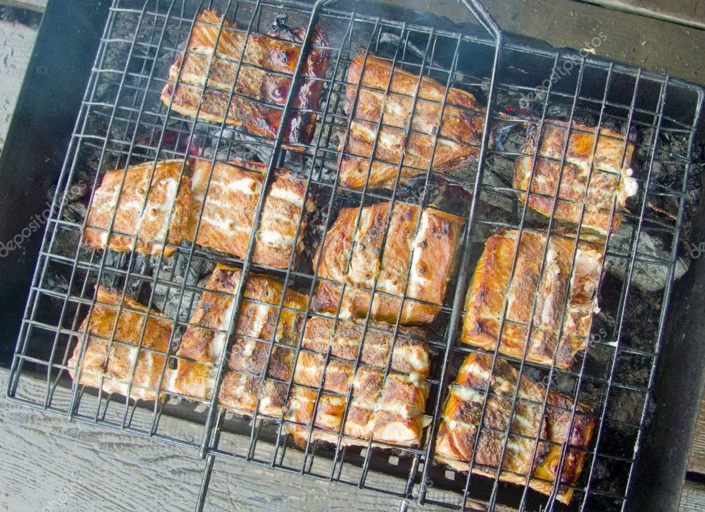 Grilled pieces of fish on the grill