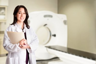 Female doctor radiologist at CT CAT scan with chart