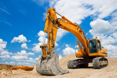 Yellow Excavator at Construction Site stock vector
