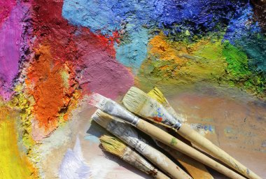 Oil paints and paint brushes on a palette stock vector
