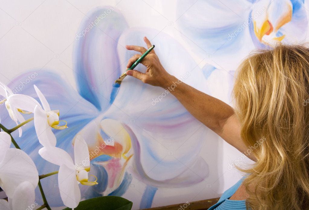 Female artist painting phalaenopsis orchids