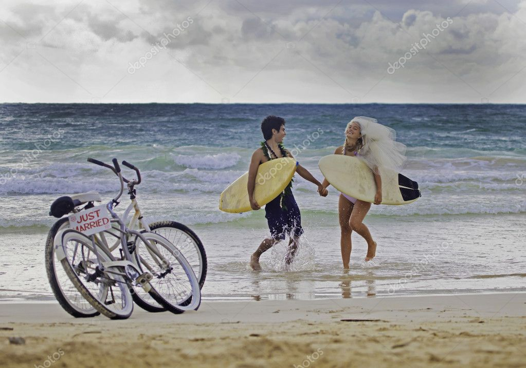 Newlywed couple at the beach