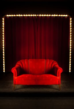 Red sofa on the stage