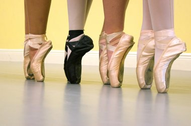 Ballet dancers feet in pointe shoes
