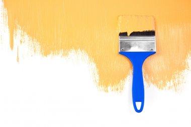 Orange painted shape with brush / white background