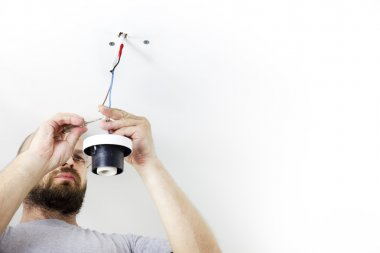 Electrician Installing Celling Light / House worker / Repairman