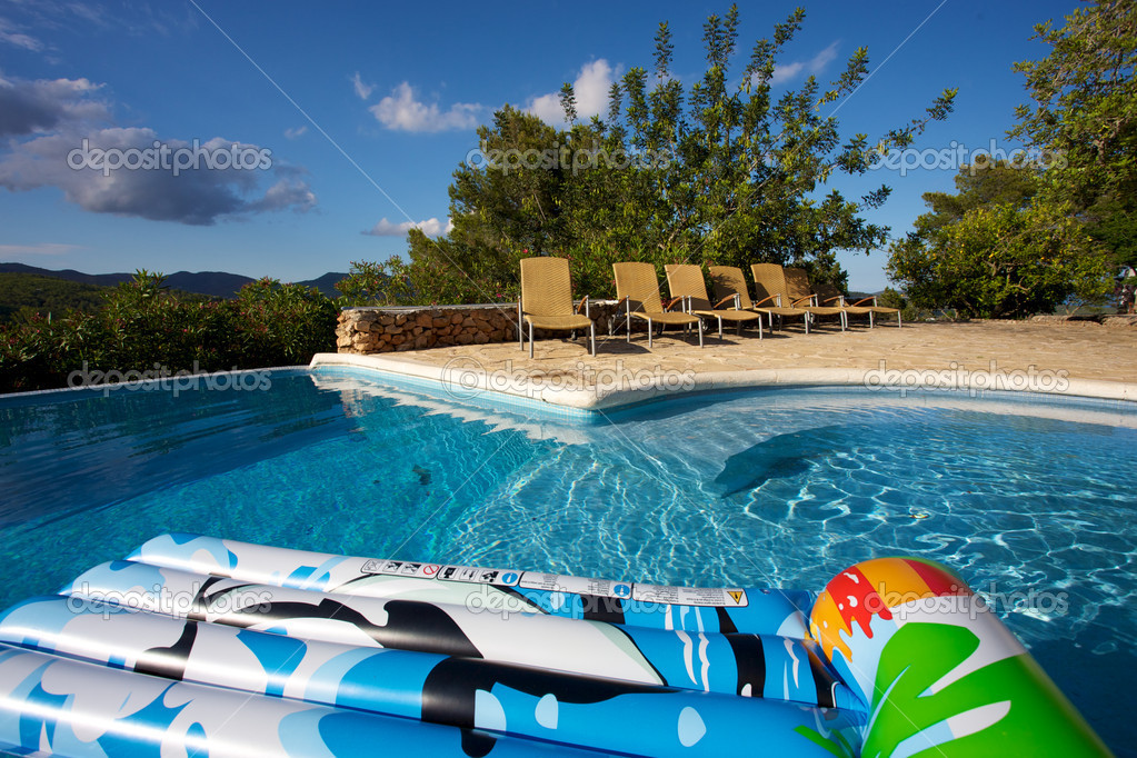 Air bed floating on a swimming pool