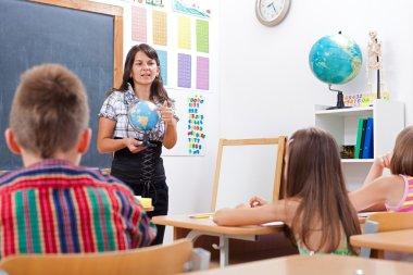 Teacher explaining about Earth globe