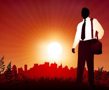 Traveling Businessman on sunset background