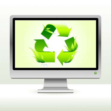green recycle symbol on computer screen background