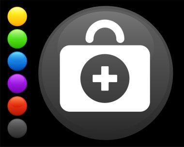first aid kit icon on round internet button
