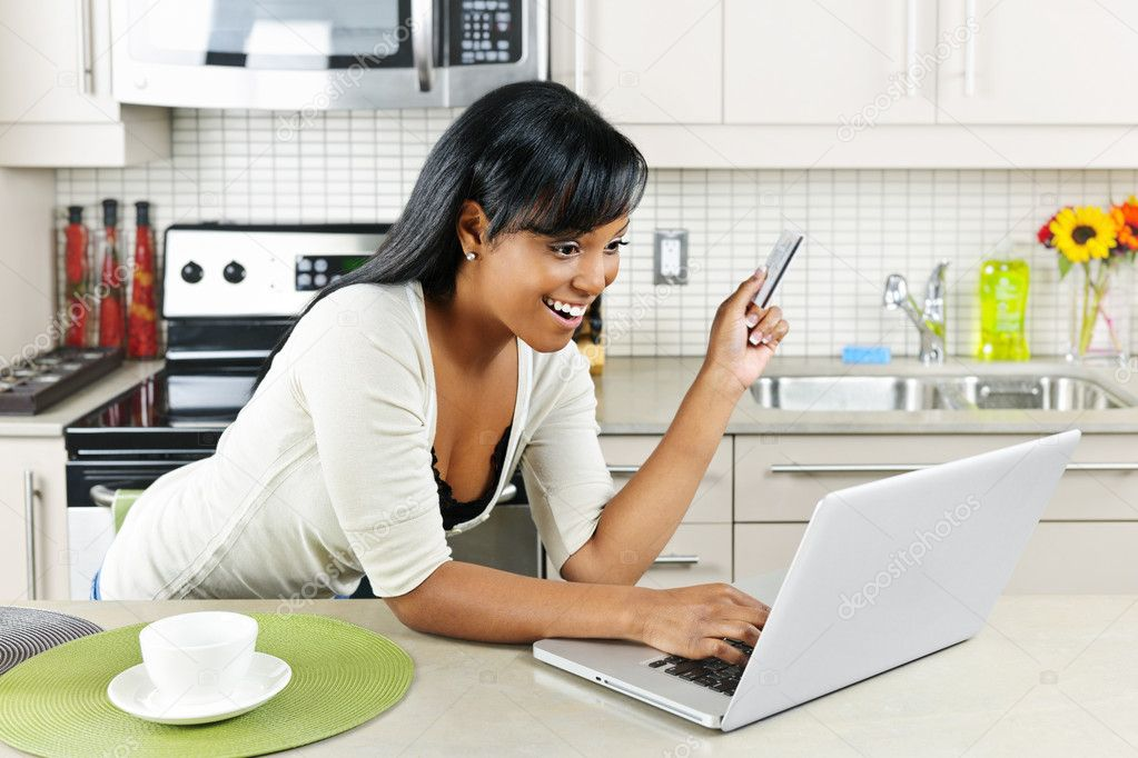 Woman shopping online at home stock photo elenathewise for Shopping for home
