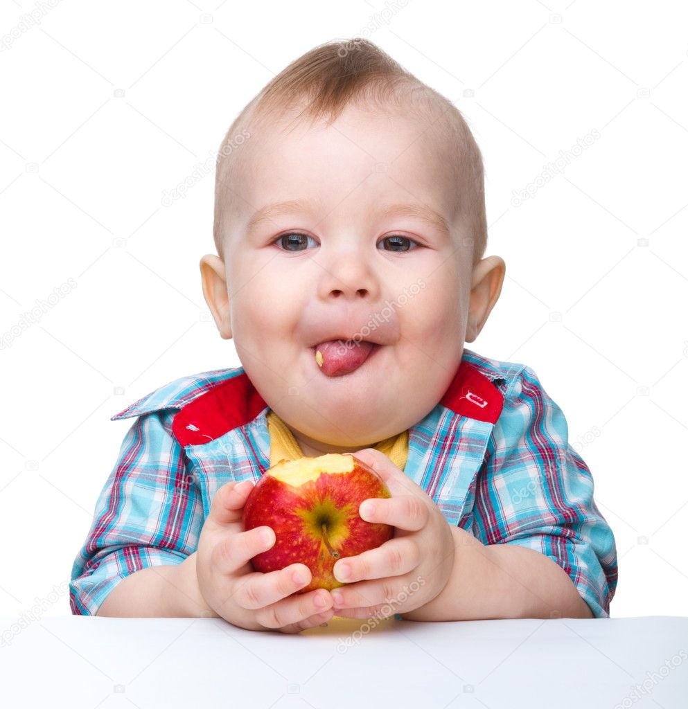 작은 아이 빨간 사과 먹고 있다 — 스톡 사진 © Kobyakov #5414441