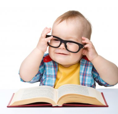 Little child play with book and glasses