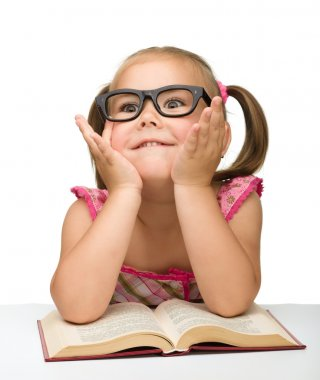 Little girl play with book