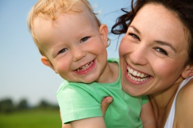 Child with mother play outdoors