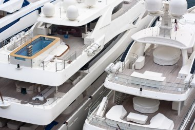 Luxurious triple deck yachts