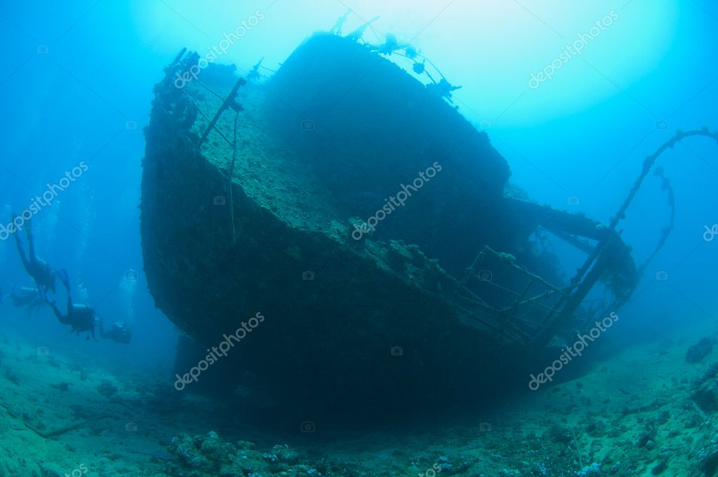 Scuba divers on a large shipwreck