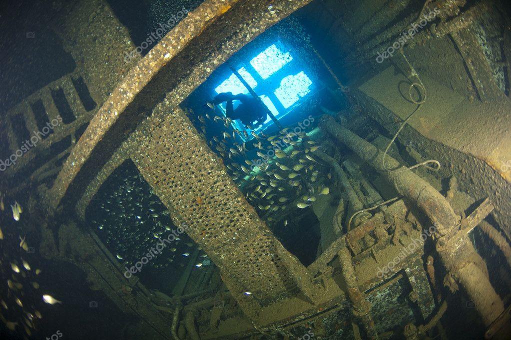 Diver exploring inside a shipwreck
