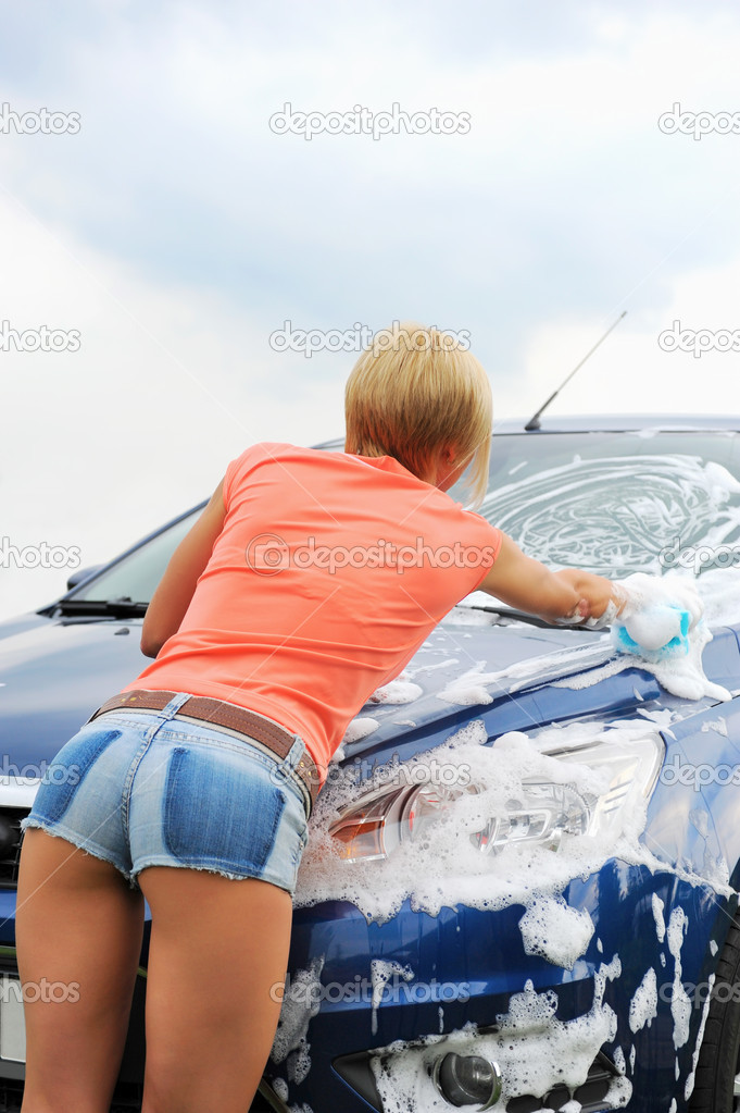 Sexy woman cleaning car photos