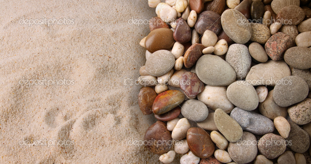 Colorful river stones on sand