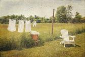 Fényképek fehér pamut ruhák szárítás mosás sorban