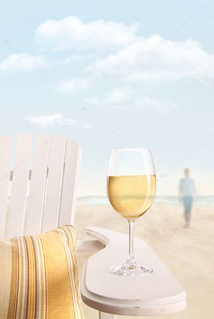 Glass of white wine on adirondack chair