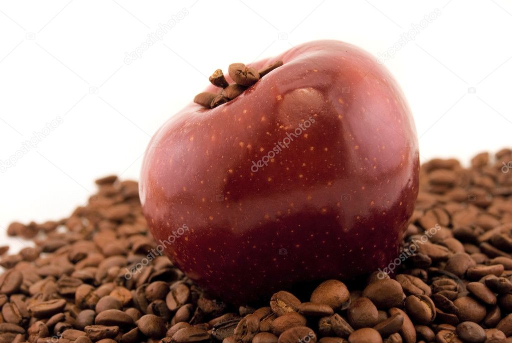 Red apple and coffee beans isolated on white