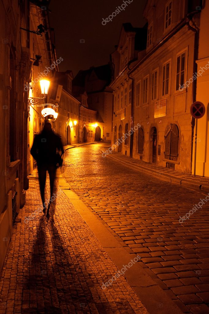 A beautiful night view of the street and the shadow of a man in