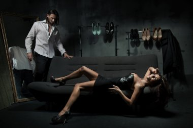 Sexy fashionable couple in dark room